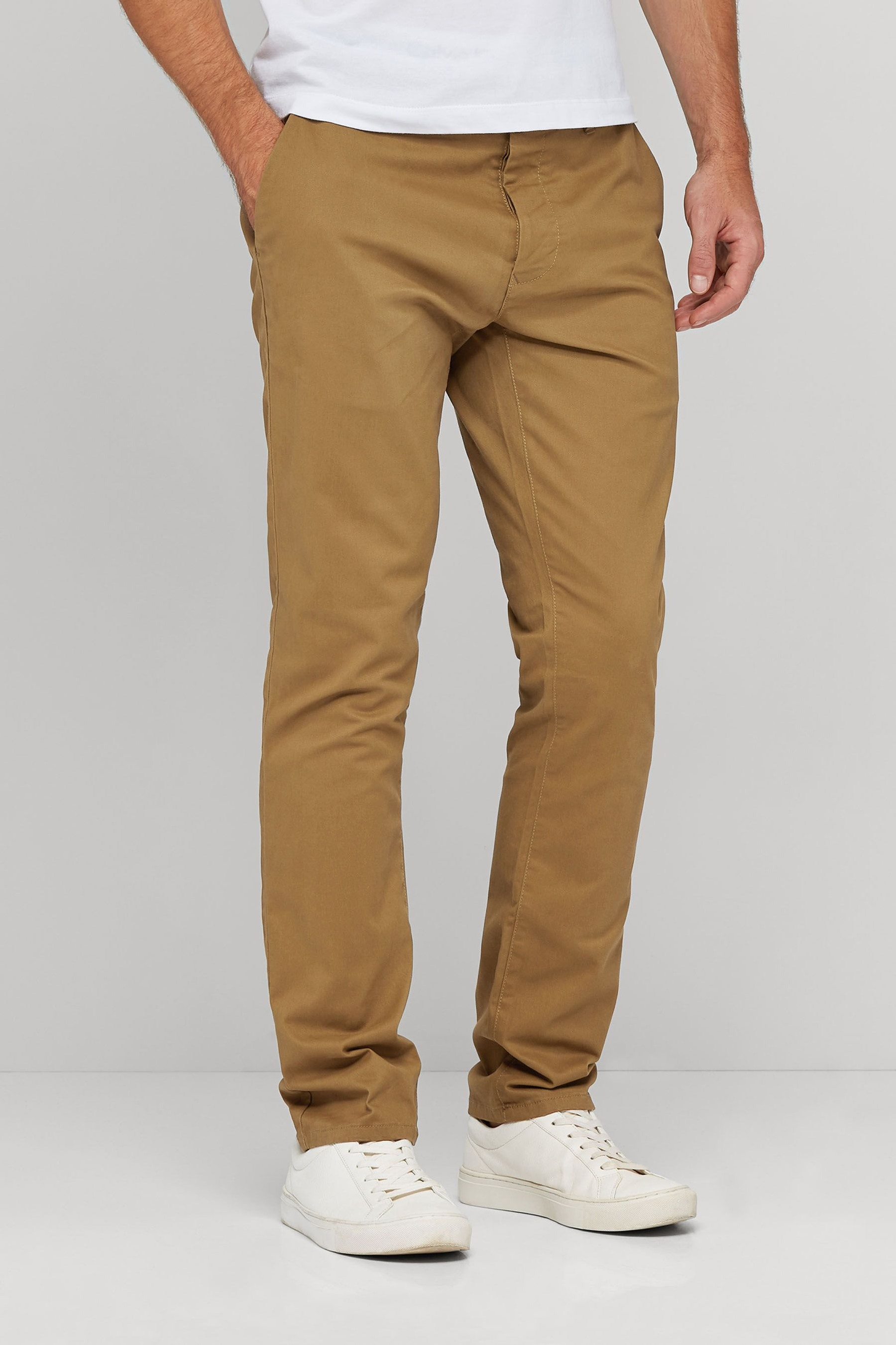 Shop Banana Republic's Aiden Slim Rapid Movement Chino: Rapid Movement Chinos: Tailored performance chinos designed to do more. Engineered with stretch for a comfortable fit that keeps its shape, with added water and stain resistant properties.,Front coin and off-seam pockets. Rear buttoned welt pockets.,Zip fly with hook-and-bar closure.,Belt loops.