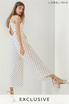 Mix/Kitri Studio Cross Back Polka Dot Jumpsuit