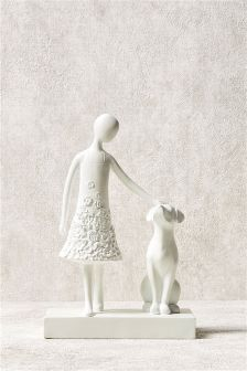 Pretty girl and dog sculpture